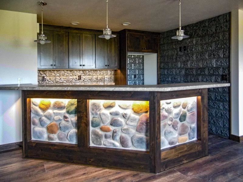 Home bar island with stone and lighting