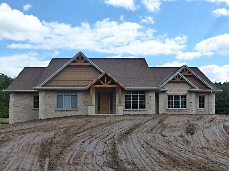 New home construction with brick exterior