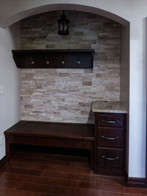 Foyer with bench, cabinet drawers, hooks, and light