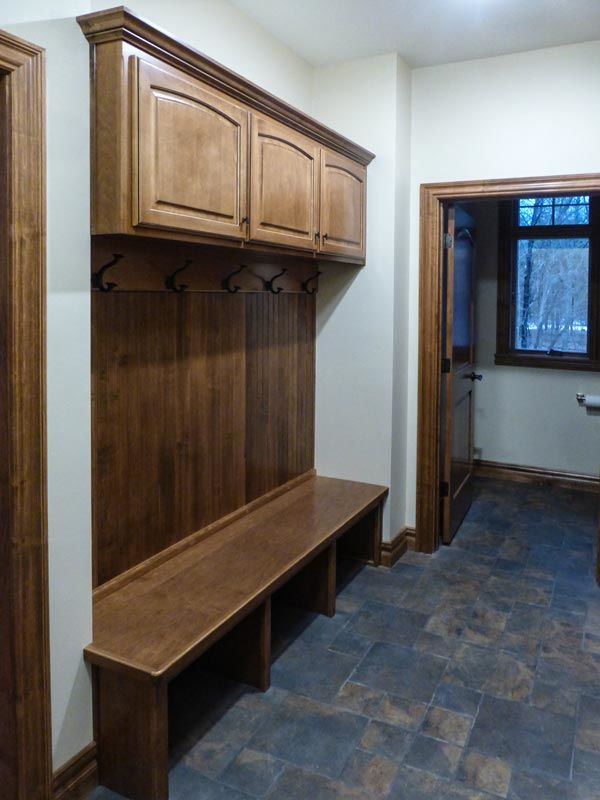 Foyer with bench, hooks, storage, and bathroom access
