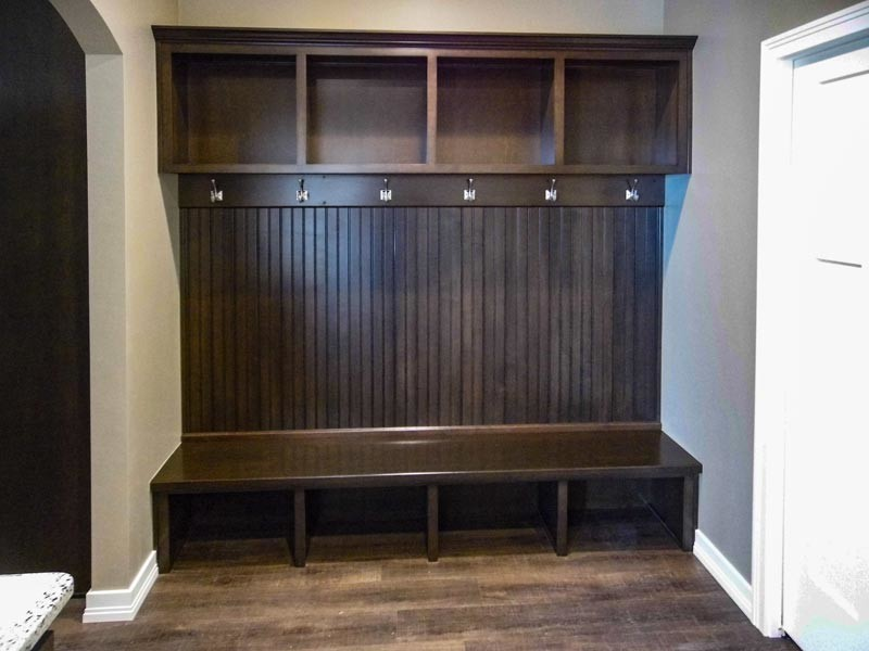 Foyer with bench, hooks, and storage