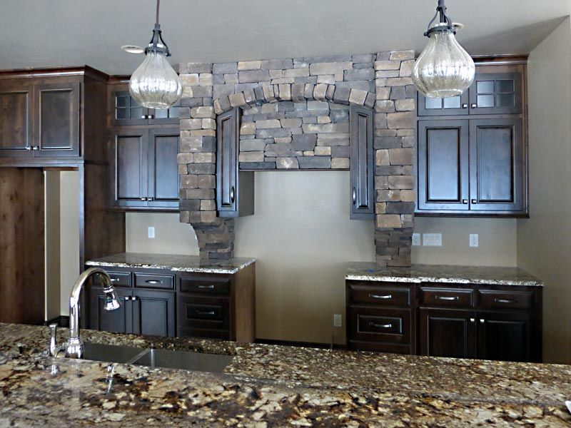 Kitchen with stone over stove