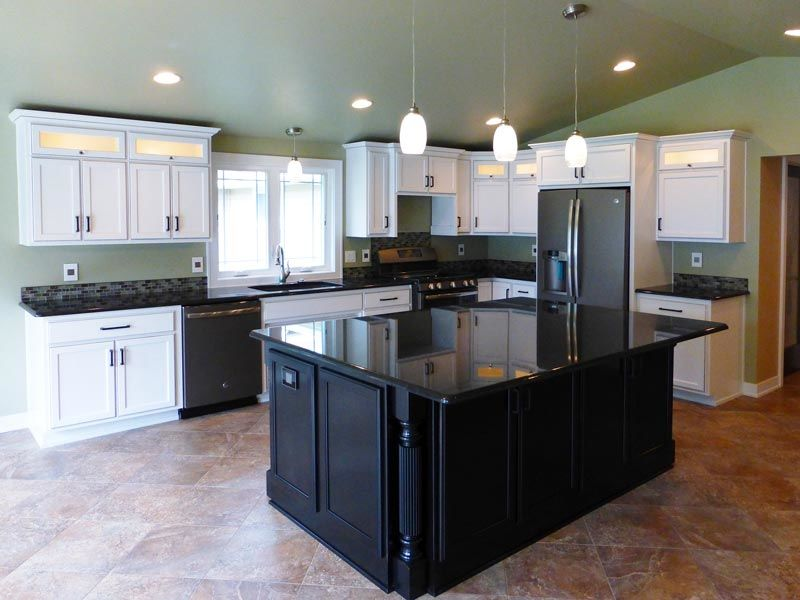 Kitchen design with white cabinets mixed with black