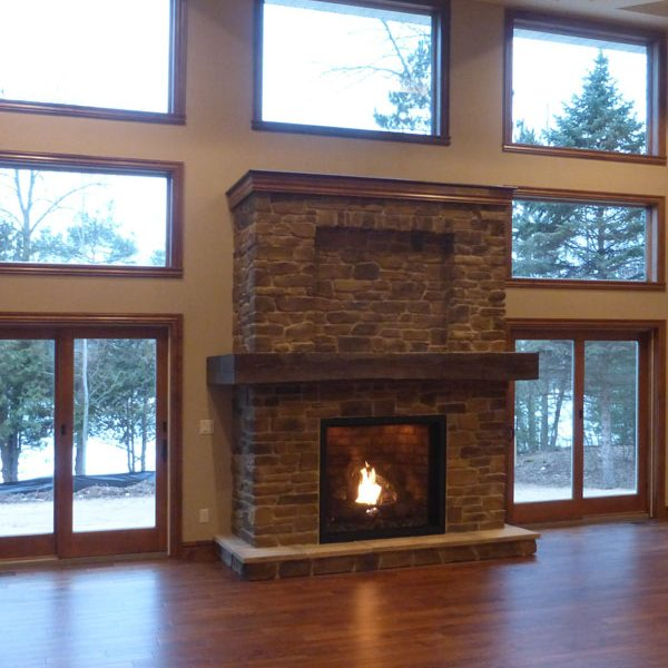 Fireplace surrounded by windows