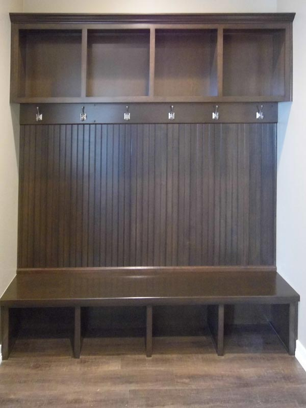 Foyer with bench, hooks and storage