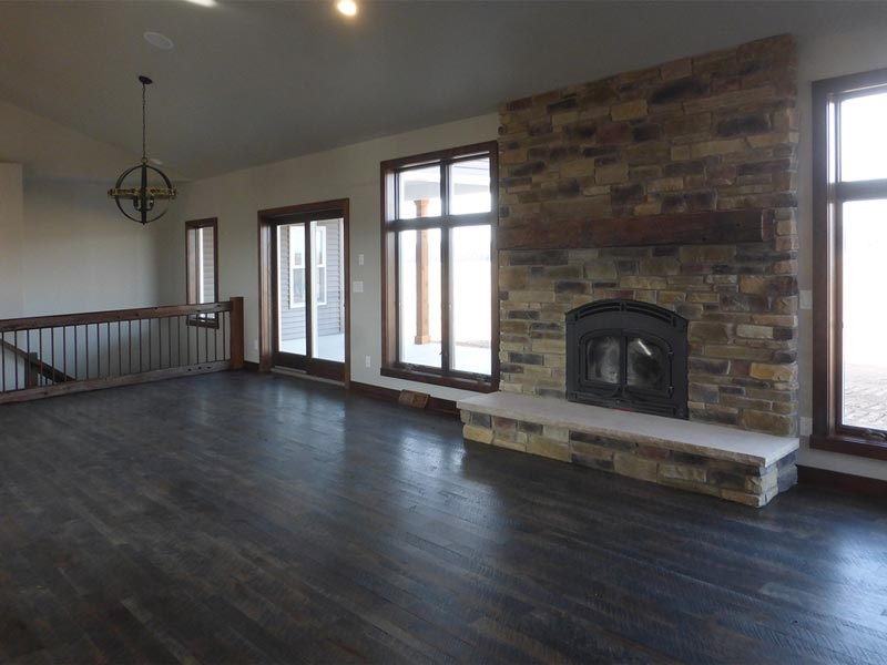 Living are with floor to ceiling fireplace