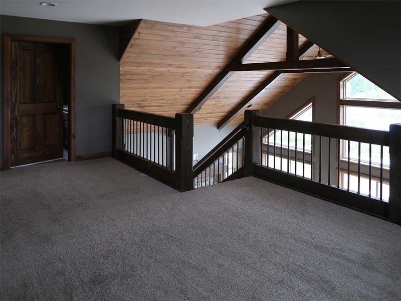 Stairway upper level wood ceiling