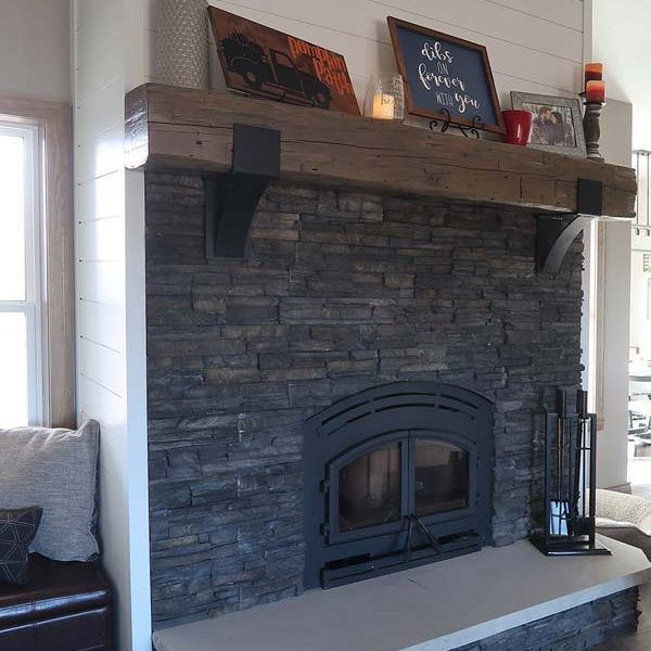 Fireplace with Stone, Beam Shelf and Shiplap Surround