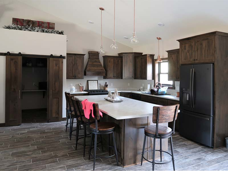 Kitchen design with island and pantry with barn door
